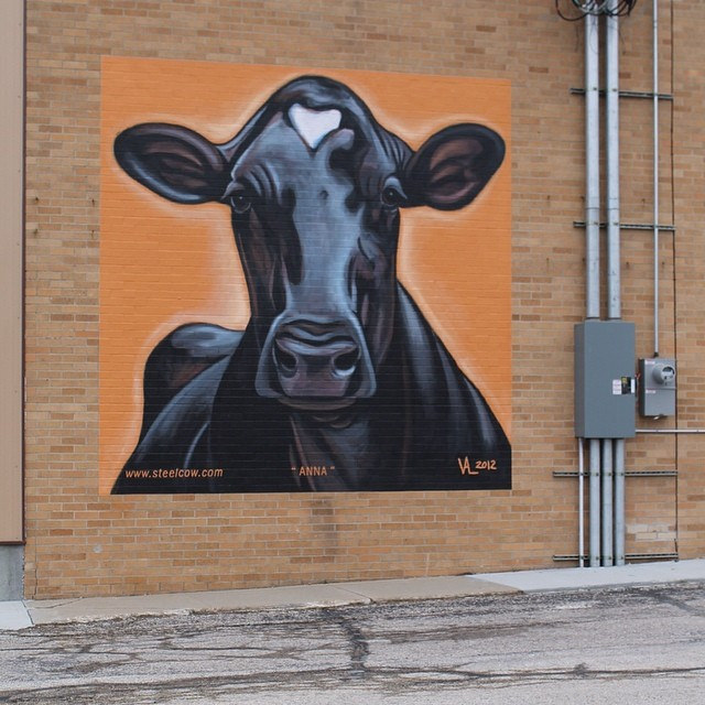 Cow mural on the side of WW Homestead Dairy building